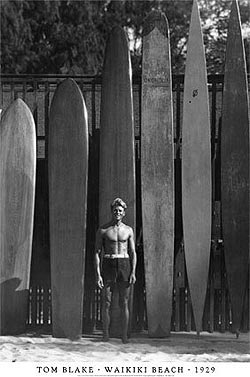 Tom Blake and some of his hollow surfboards on the right