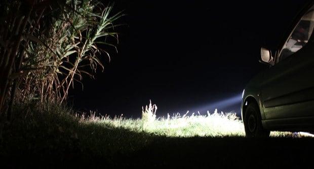Car lights aiming at the sea.