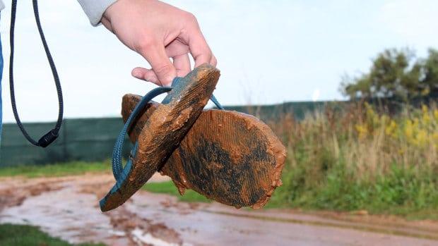 dirty muddy flip flops