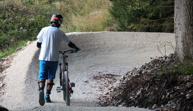 Biker walking on a MTB trail