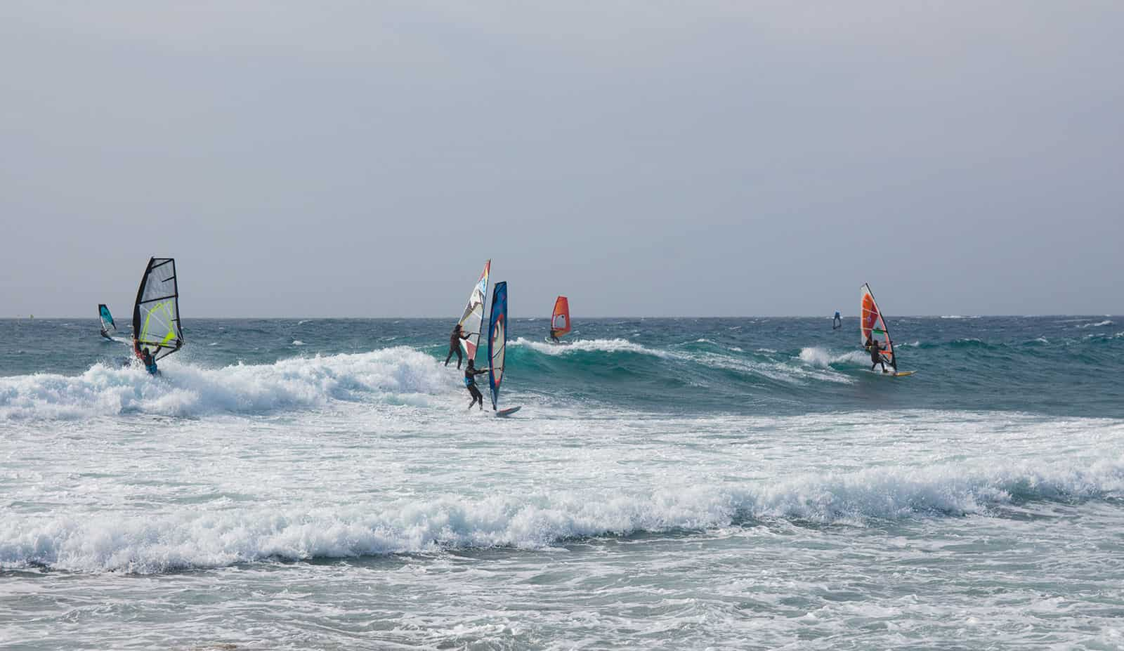 Even getting in and out with all the equipment looks sketchy :) Party wave windsurf style.