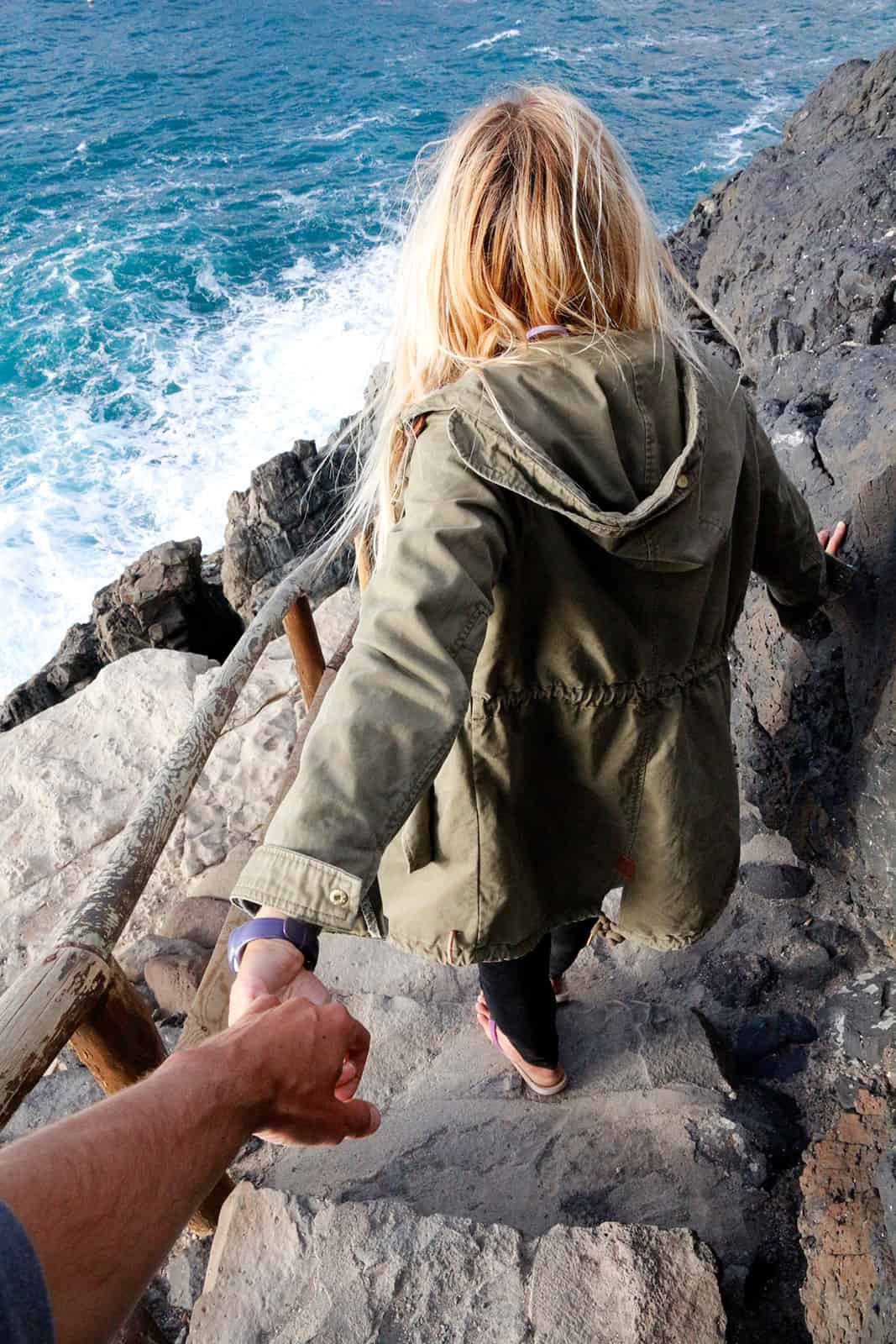Let your girlfriend take you to the right of the bay and follow the path to the caves.