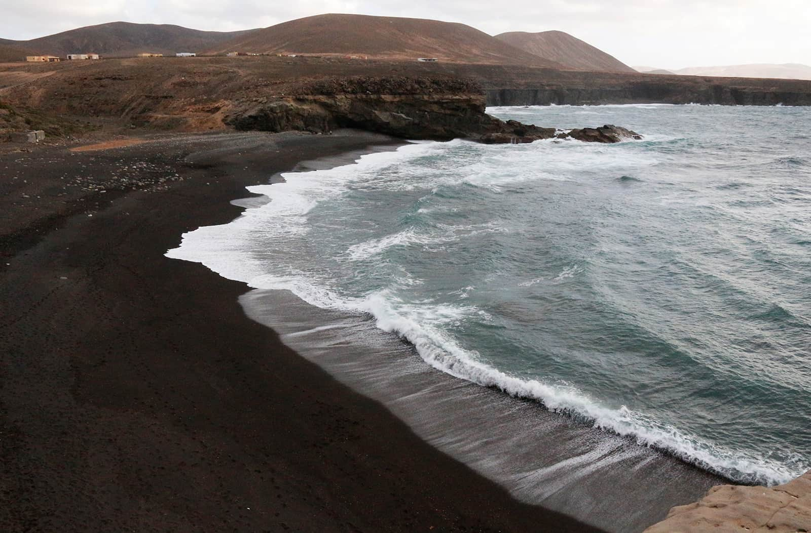 Black sand beach at Ajuy. But the beach is not the reason to go here.