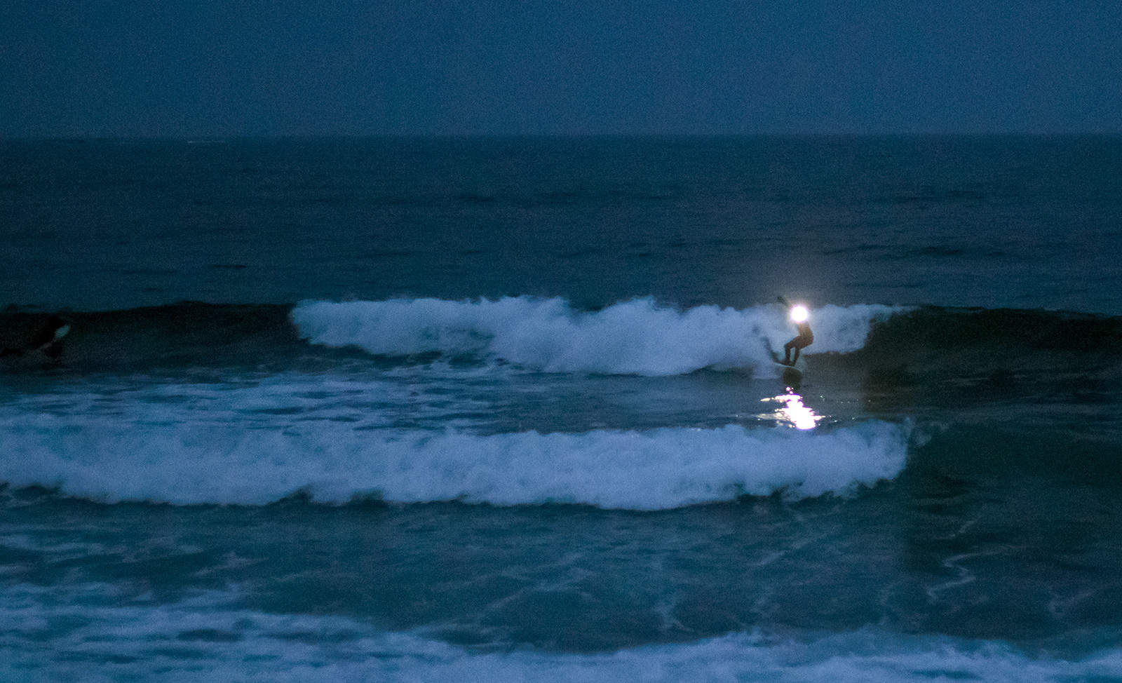 Night surfing. Photo: Miha Godec